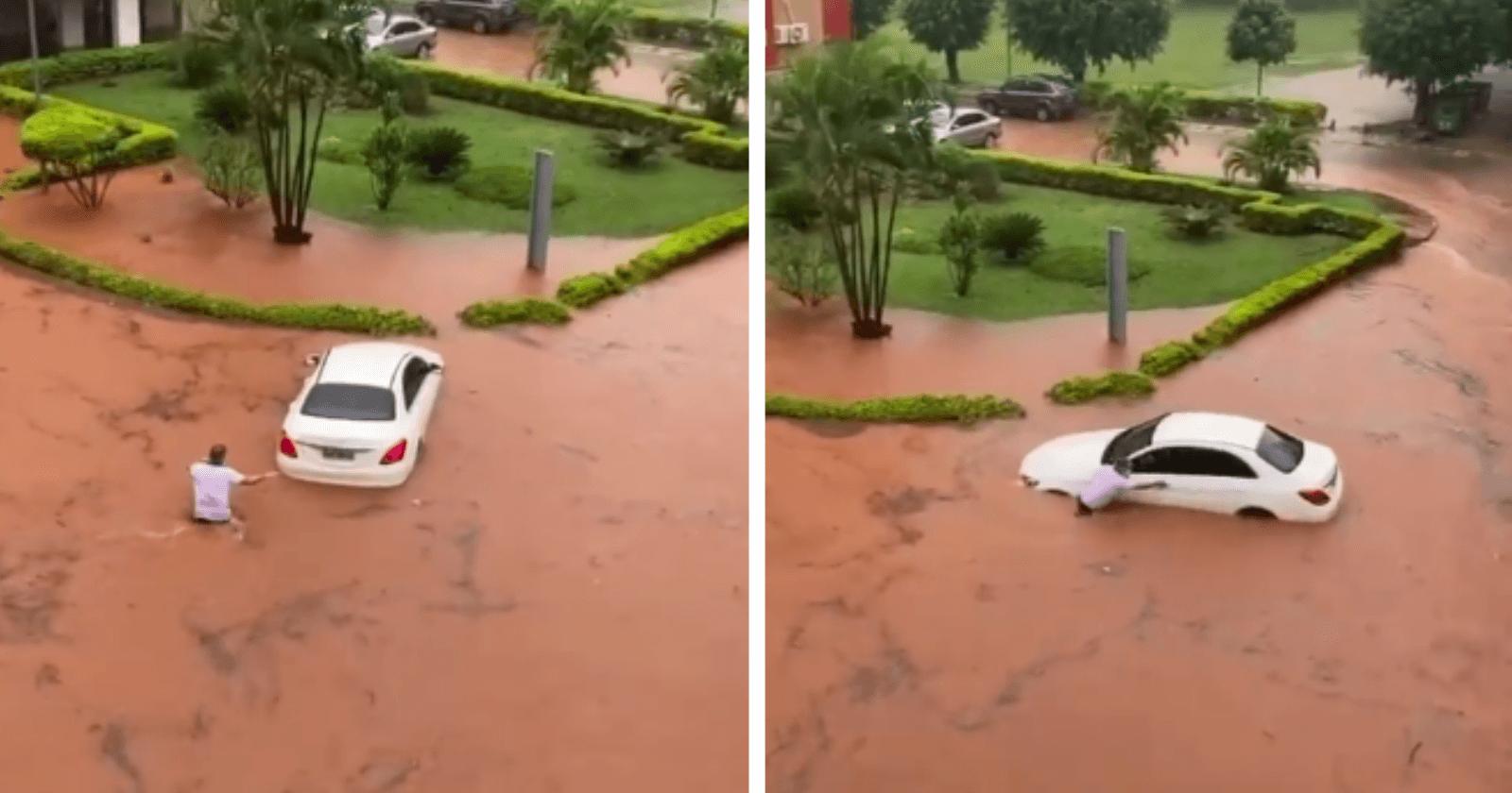 GENTILEZA: Homem entra no meio de enchente para ajudar motorista a salvar seu carro