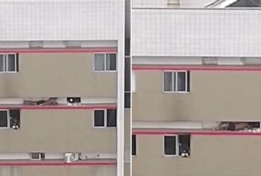 Rapaz se salva de incêndio ao se arrastar pela fachada do prédio até os bombeiros