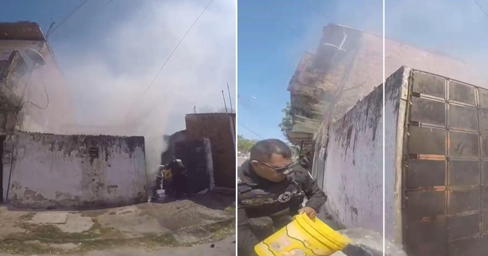 Policial carrega idoso desacordado de casa em chamas